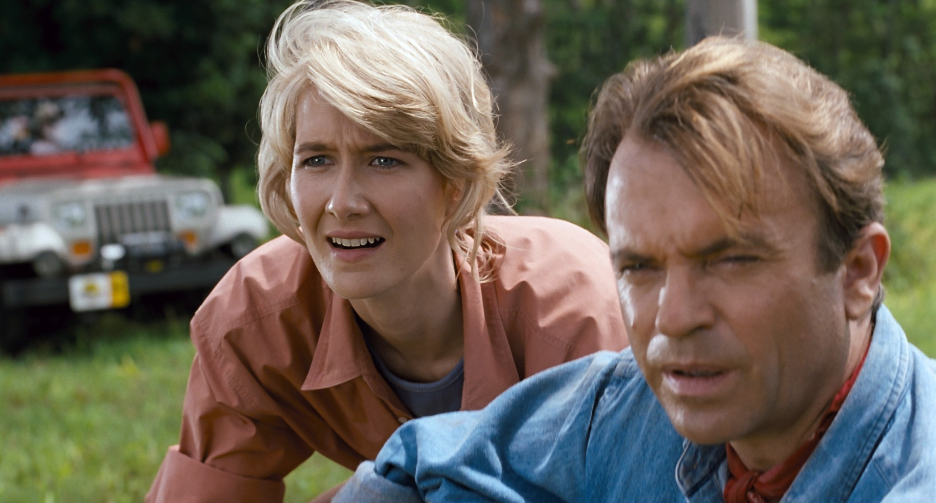Laura Dern and Sam Neill in Jurassic Park (1993), directed by Steven Spielberg.